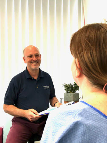 Patient consultation with Jeff Shurr of Preston Chiropractic Associates